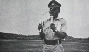 Soldier at work with dowsing rods during British Army experiments in Dorset, UK, 1968